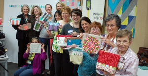 Happy polka dot people with their new bags.