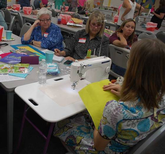 Alyssa teaching a group about free motion quilting