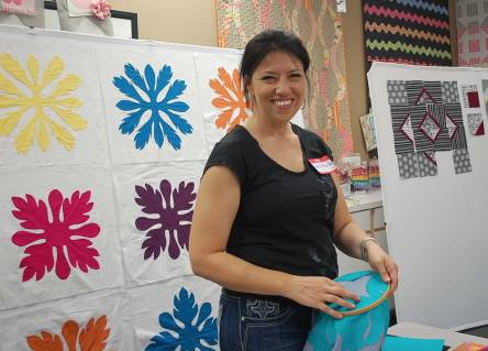 Jen showing a group the art of Hawaiian applique