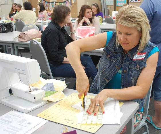 Lisa demonstrating paper piecing